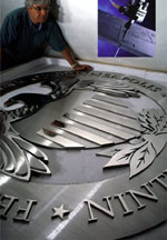 Federal Reserve Bank Solid Metal Medallion. Three layers of solid stainless steel. 7' diameter polished satin and textured surfaces.