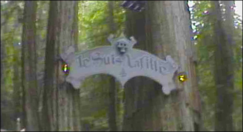 A screenshot from Alex Jones' film on the Grove, in 2000. At the time, speculation on the internet was rampant as to what in the world in could mean. It turns out that Alex had filmed the entrance to the featured Grove play for that year: 'Je Suis LaFitte,' by James C. Crimmins, about the famous pirate.